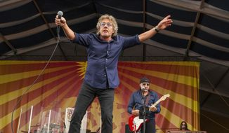In this April 25, 2015 file photo, Roger Daltrey and Pete Townshend perform with The Who at the New Orleans Jazz & Heritage Festival, in New Orleans. (Photo by Barry Brecheisen/Invision/AP, File)