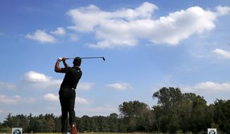 Jason Day, of Australia, watches his tee shot on the fifth hole during the first round of the BMW Championship golf tournament at Conway Farms Golf Club, Thursday, Sept. 17, 2015, in Lake Forest, Ill. (AP Photo/Charles Rex Arbogast)