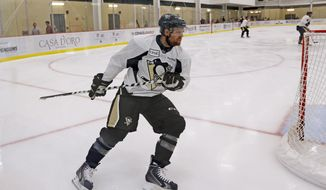 Pittsburgh Penguins' Phil Kessel skates during a drill at NHL hockey training camp, Friday, Sept. 18, 2015, in Cranberry Township, Pa. (AP Photo/Keith Srakocic)