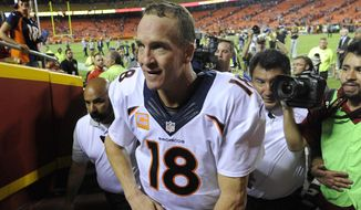 Denver Broncos quarterback Peyton Manning leaves the field following the Broncos' 31-24 win over the Kansas City Chiefs in an NFL football game in Kansas City, Mo., Thursday, Sept. 17, 2015. (AP Photo/Ed Zurga)