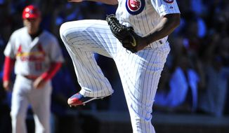 Chicago Cubs relief pitcher Pedro Strop (46) reacts after getting St. Louis Cardinals' Stephen Piscotty (55) to ground into a fielders choice to end the game during the ninth inning of a baseball game, Saturday, Sept. 19, 2015, in Chicago. The Cubs won 5-4. (AP Photo/David Banks)