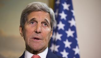 Secretary of State John Kerry answers a question about the ongoing crisis in Syria during a news conference with British Foreign Secretary Philip Hammond, on Saturday, Sept. 19, 2015, in London. (AP Photo/Evan Vucci, Pool)