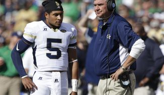 Georgia Tech head coach Paul Johnson talks with quarterback Justin Thomas (5) during the first half of an NCAA college football game against Notre Dame in South Bend, Ind., Saturday, Sept. 19, 2015. (AP Photo/Michael Conroy)
