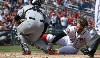 Washington Nationals' Bryce Harper, right, continues his slide as he is safe at home against Miami Marlins catcher Tomas Telis, left, on a hit by Jayson Werth during the first inning of a baseball game, Sunday, Sept. 20, 2015, in Washington. (AP Photo/Nick Wass)