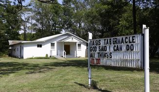 The Oasis Tabernacle Church is seen in East Selma, Ala., on Sunday, Sept. 20, 2015. Dallas County District Attorney Michael Jackson says suspect James Minter has been charged with three counts of attempted murder after allegedly shooting a woman, an infant and a pastor inside the church. (Alaina Denean Deshazo/The Selma Times-Journal via AP)