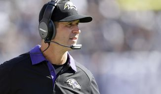Baltimore Ravens head coach John Harbaugh watches from the sideline as his team plays the Oakland Raiders during the second half of an NFL football game, Sunday, Sept. 20, 2015, in Oakland , Calif. (AP Photo/Ben Margot)