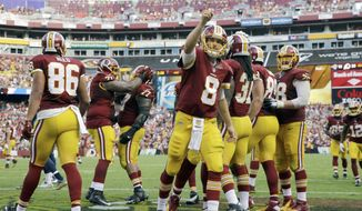 Washington Redskins quarterback Kirk Cousins (8) points towards the fans as he walks off the field after running back Matt Jones' touchdown during the second half of an NFL football game against the St. Louis Rams in Landover, Md., Sunday, Sept. 20, 2015. The Redskins won their first game of the regular season defeating the St. Louis Rams 24-10. (AP Photo/Patrick Semansky)