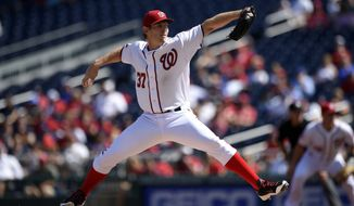 Washington Nationals starting pitcher Stephen Strasburg (37) delivers a pitch against the Miami Marlins during the first inning of a baseball game, Sunday, Sept. 20, 2015, in Washington. (AP Photo/Nick Wass)