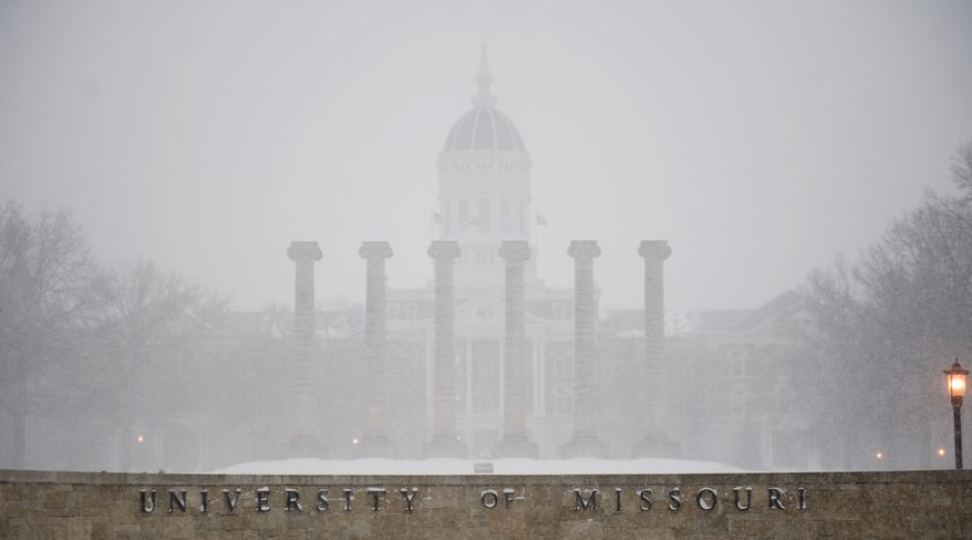 """Royce de R. Barondes, an associate professor of law at the University of Missouri, is challenging the campus' policy that """"the possession of firearms on university property is prohibited except in regularly approved programs or by university agents or employees in the line of duty."""" (Associated Press)"""