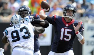 Houston Texans' Ryan Mallett (15) looks to pass under pressure from Carolina Panthers' Kyle Love (93) during the first half of an NFL football game in Charlotte, N.C., Saturday, Sept. 19, 2015. (AP Photo/Mike McCarn)