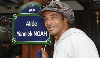 FILE - In this May 27, 2008 file photo, former tennis ace Yannick Noah, of France, winner of the French Open tennis tournament in 1983, inaugurates a walking path which bears his name, at the Roland Garros stadium in Paris. Yannick Noah, the last Frenchman to win a Grand Slam tournament, has been appointed as the new France Davis Cup captain, Monday Sept.21, 2015. (AP Photo/Michel Spingler, File)