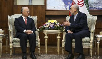 Head of Iran's Atomic Energy Organization Ali Akbar Salehi, right, talks with Director General of the International Atomic Energy Agency (IAEA) Yukiya Amano during their meeting in Tehran, Iran, Sunday, Sept. 20, 2015. Amano's visit comes less than a month before an Oct. 15 deadline to gather information on allegations that Iran had in the past tried to build atomic weapons. A final U.N. assessment is due in December. (AP Photo/Vahid Salemi)