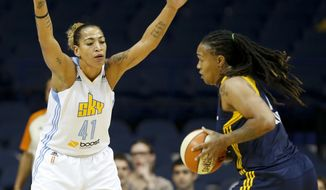 Chicago Sky forward Erika de Souza, left, defends against Indiana Fever forward Erlana Larkins, right, during the first half of Game 3 of the WNBA basketball Eastern Conference semifinals, Monday, Sept. 21, 2015, in Rosemont, Ill. (AP Photo/Kamil Krzaczynski)