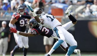 FILE - In this Sunday, Sept. 20, 2015 file photo, Carolina Panthers' Devin Funchess (17) misses a catch as Houston Texans' Kevin Johnson (30) defends during the second half of an NFL football game in Charlotte, N.C.  Carolina Panthers quarterback Cam Newton said he's never lost faith in his wide receivers despite the drops that have plagued the unit since the middle of the preseason. That trust has paid off as the Panthers defeated the Texans  24-17. (AP Photo/Bob Leverone)