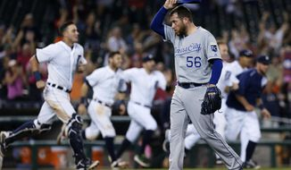 Kansas City Royals pitcher Greg Holland (56) walks off the field after giving up a game-winning RBI single to Detroit Tigers' Dixon Machado during the 12th inning of a baseball game Friday, Sept. 18, 2015, in Detroit. The Tigers defeated the Royals 5-4. (AP Photo/Duane Burleson)