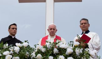 Holy orders: Pope Francis looks out from the Hill of the Cross in Holguin, Cuba, Monday as he entreated the island nation to adapt some of its more conservative views. Francis faces some backlash from U.S. Catholics for his more liberal views on such issues as same-sex unions and climate change. Story A8. (Associated Press)