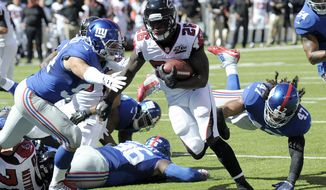 Atlanta Falcons running back Tevin Coleman (26) scores a touchdown against the New York Giants during the first half of an NFL football game, Sunday, Sept. 20, 2015, in East Rutherford, N.J. (AP Photo/Bill Kostroun)