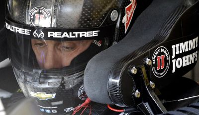 Kevin Harvick gets ready for practice for the NASCAR Sprint Cup Series auto race at Chicagoland Speedway, Saturday, Sept. 19, 2015, in Joliet, Ill. (AP Photo/Nam Y. Huh)