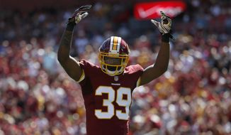 Washington Redskins cornerback David Amerson (39) reacts during the first half of an NFL football game against the Jacksonville Jaguars Sunday, Sept. 14, 2014, in Landover, Md. (AP Photo/Evan Vucci)