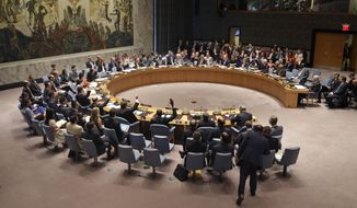 In this July 20, 2015, file photo, members of the Security Council vote at United Nations headquarters. The Obama administration may abstain for the first time from the annual United Nations vote condemning the U.S. trade embargo against Cuba, officials told The Associated Press. (AP Photo/Seth Wenig, File)
