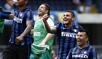 From left, Inter Milan's players Fredy Guarin, Juan Pablo Carrizo, Mauro Icardi and Gary Medel celebrate at the end of a Serie A soccer match against Chievo at Bentegodi stadium in Verona, Italy, Sunday, Sept. 20, 2015. Inter won 1-0. (AP Photo/Felice Calabro')