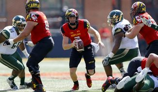 Maryland quarterback Caleb Rowe, center, rushes the ball in the first half of an NCAA college football game against South Florida, Saturday, Sept. 19, 2015, in College Park, Md. Maryland won 35-17. (AP Photo/Patrick Semansky)