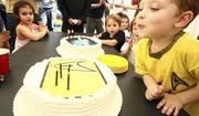 Mason Anthony, 4, blows out the candles on his cake at his birthday party in Bloomfield, N.J., on June 16, 2007. (Associated Press) **FILE**