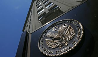 The seal a fixed to the front of the Department of Veterans Affairs building in Washington. (AP Photo/Charles Dharapak)