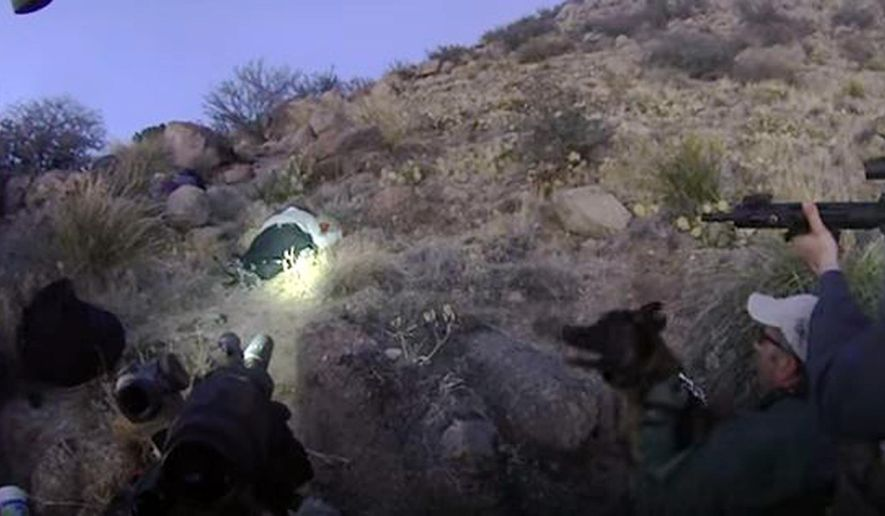 This March 16, 2014 still frame from video released by the Albuquerque, N.M., Police Department shows officers training their weapons on James Boyd, a homeless man, after he was shot  by police in Albuquerque, N.M. Boyd later died at an Albuquerque hospital. The police service dog Rex is seen at lower right in the frame in the lower right. Police say Rex, that was unleashed after the shooting, is being retired and may be put to sleep. Police spokeswoman Celina Espinoza said Monday, Sept. 21, 2015, that Rex's time on the force is ending after his handler, Officer Scott Weimerskirch, retired Friday. (Albuquerque Police Department via AP)