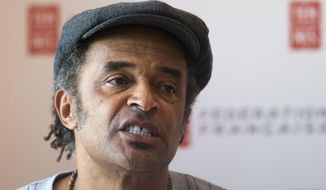 Yannick Noah, the last Frenchman to win a Grand Slam tournament, smiles during a  press conference at the Roland Garros stadium in Paris, France, Tuesday, Sept. 22, 2015. Noah has been appointed as the new France Davis Cup captain Monday. (AP Photo/Jacques Brinon)