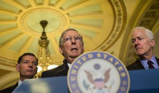 Senate Majority Leader Mitch McConnell of Ky., center, flanked by Sen. John Barrasso, R-Wyo., left, and Senate Majority Whip John Cornyn of Texas, speaks during a news conference Capitol Hill in Washington, Tuesday, Sept. 22, 2015. Earlier, Senate Democrats blocked Republican legislation Tuesday that would prohibit most late-term abortions, the latest episode in a fight that has threatened to cause a partial government shutdown. At the same time, the chamber's GOP leader began choreographing a series of votes designed to avert a federal closure. (AP Photo/Jacquelyn Martin) **FILE**