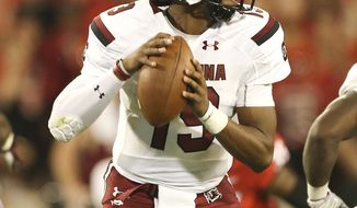 FILE- In tihs Sept. 19, 2015, file photo, South Carolina quarterback Lorenzo Nunez drops back to throw in the second half of an NCAA college football game against Georgia in Athens, Ga. South Carolina will start its third different quarterback Saturday when freshman Lorenzo Nunez takes the field against Central Florida. Nunez replaces Perry Orth, who struggled in a 52-20 loss to Georgia last week after being pressed into duty when a separated shoulder and bruised hip sidelined starter Connor Mitch. (AP Photo/John Bazemore, File)