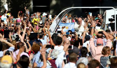 mass crowd: Pope Francis arrives in the popemobile at the Basilica of the National Shrine of the Immaculate Conception on Wednesday for the canonization Mass for Junipero Serra.