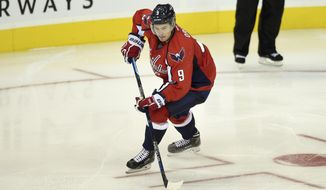 Washington Capitals defenseman Dmitry Orlov (9), of Russia, skates with the puck against Carolina Hurricanes during the third period of an NHL preseason hockey game, Monday, Sept. 21, 2015, in Washington. The Capitals won 2-0. (AP Photo/Nick Wass)
