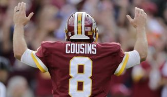 Washington Redskins quarterback Kirk Cousins reacts to running back Matt Jones' touchdown during the second half of an NFL football game against the St. Louis Rams in Landover, Md., Sunday, Sept. 20, 2015. The Redskins defeated the Rams 24-10. (AP Photo/Mark Tenally)