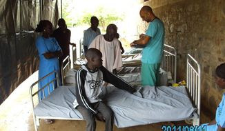 Dr. Tom Catena treats patients seeking help at the Mother of Mercy Hospital in the Nuba Mountains. Source: Sudan Relief Fund.