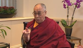 "The Dalai Lama says he is open to the idea of a female successor as long as she's ""very, very attractive."" (YouTube/BBC News)"
