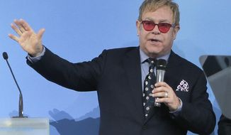 "FILE - This is a  Saturday, Sept. 12, 2015 file photo of Elton John speaking  in Kiev. Russian President Vladimir Putin has called British musician Elton John and agreed to meet with him after Russian pranksters called him, pretending to be Putin and his spokesman. Putin's spokesman Dmitry Peskov told Russian news agencies on Thursday sept. 24, 2015 , that Putin called John earlier in the day and ""asked him not to feel offended"" by the prank. Putin promised to meet John as long as the schedule permits and discuss ""any issues that he is concerned about."" (AP Photo/Efrem Lukatsky, File)"