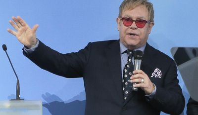 """FILE - This is a  Saturday, Sept. 12, 2015 file photo of Elton John speaking  in Kiev. Russian President Vladimir Putin has called British musician Elton John and agreed to meet with him after Russian pranksters called him, pretending to be Putin and his spokesman. Putin's spokesman Dmitry Peskov told Russian news agencies on Thursday sept. 24, 2015 , that Putin called John earlier in the day and """"asked him not to feel offended"""" by the prank. Putin promised to meet John as long as the schedule permits and discuss """"any issues that he is concerned about."""" (AP Photo/Efrem Lukatsky, File)"""