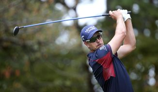 Henrik Stenson watches his tee shot on the 14th hole during the first round of the Tour Championship golf tournament at East Lake Club Thursday, Sept. 24, 2015, in Atlanta. (AP Photo/John Bazemore)
