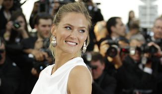 "Bar Refaeli arrives for the opening ceremony and the screening of the film ""La Tete Haute (Standing Tall)"" at the 68th international Cannes film festival in southern France on May 13, 2015. (Associated Press) **FILE**"