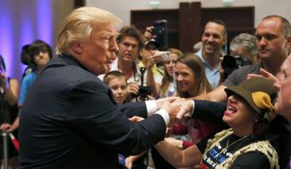 Republican presidential candidate, businessman Donald Trump, greets supporters after speaking at an event sponsored by the Greater Charleston Business Alliance and the South Carolina African American Chamber of Commerce at the Charleston Area Convention Center in North Charleston, S.C., Wednesday, Sept. 23, 2015. (AP Photo/Mic Smith) ** FILE **