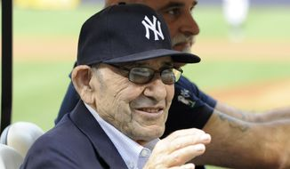 New York Yankees Hall of Fame catcher Yogi Berra waves to the fans before the baseball game against the Baltimore Orioles at Yankee Stadium, Friday, Aug. 30, 2013, in New York. (AP Photo/Bill Kostroun)