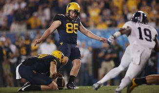 West Virginia place kicker Josh Lambert (86) during a NCAA college football game, Saturday, Sept. 5, 2015, in Morgantown, W.Va. (AP Photo/Raymond Thompson)