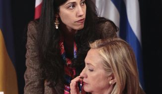 Huma Abedin, deputy chief of staff and aide to Secretary of State Hillary Rodham Clinton, wife of former New York Rep. Anthony Weiner, rear, is seen during the Open Government Partnership meeting in New York, Tuesday, Sept., 20, 2011. (AP Photo/Pablo Martinez Monsivais)