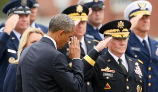 President Barack Obama salutes as he arrives next to retiring Joint Chiefs Chairman Gen. Martin Dempsey, right, for an Armed Forces Full Honors Retirement Ceremony for Dempsey, Friday, Sept. 25, 2015, at Fort Myer in Arlington, Va. (AP Photo/Andrew Harnik)