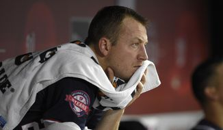 Washington Nationals starting pitcher Jordan Zimmermann watches from the dugout during the bottom of the third inning of a baseball game against the Philadelphia Phillies, Friday, Sept. 25, 2015, in Washington. (AP Photo/Nick Wass)