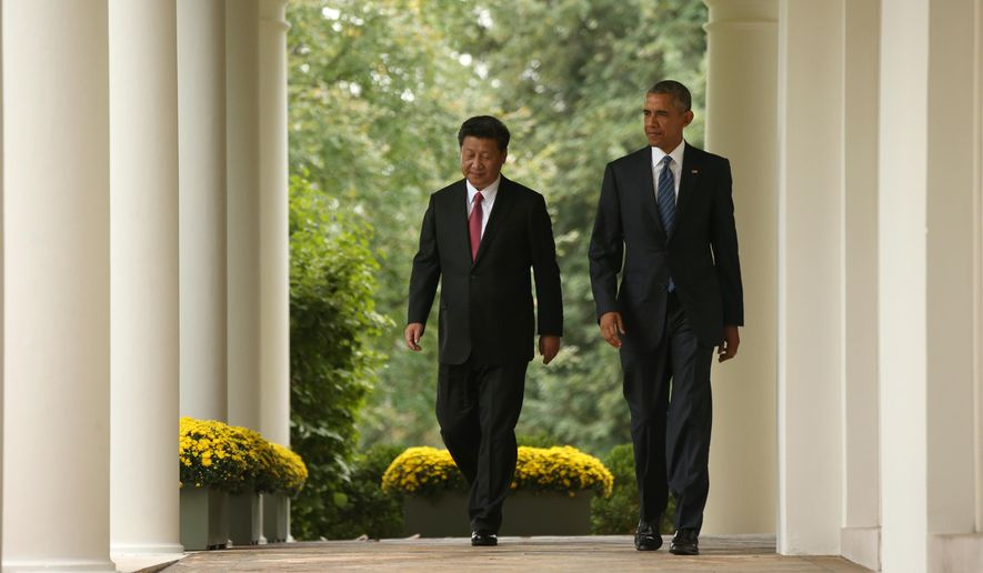 President Barack Obama and Chinese President Xi Jinping walk through the Colonnade of the White House in Washington, Friday, Sept. 25, 2015, for a news conference in the Rose Garden. (AP Photo/Andrew Harnik)