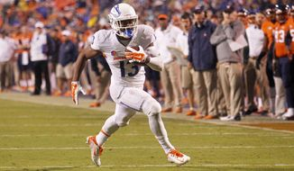 Boise State running back Jeremy McNichols (13) rushes for a touchdown during the first half of an NCAA college football game against Virginia on Friday, Sept. 25, 2015, in Charlottesville, Va. (/Ryan M. Kelly/The Daily Progress via AP) MANDATORY CREDIT