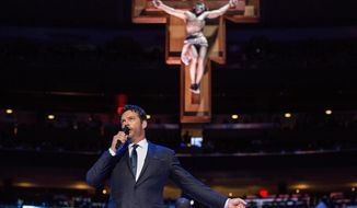 "Harry Connick Jr. sings ""How Great Thou Art"" prior to a Mass led by Pope Francis at Madison Square Garden Friday, Sept. 25, 2015 in New York. Pope Francis is visiting New York City during a six-day tour of the United States, with stops in Washington D.C., New York City and Philadelphia.  (Andrew Burton/Pool Photo via AP)"